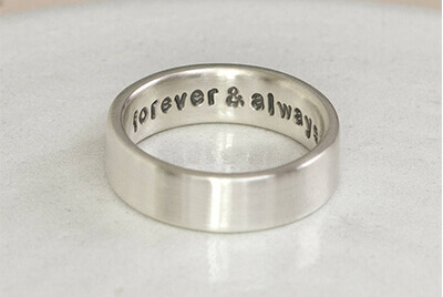 image of a memorial message written on a simple cremation ring for keepsake